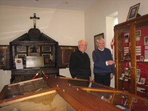 Fr. Hoole and Deacon John Monk viewing the restored reliquary